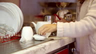 Young woman preparing tea in the kitchen video