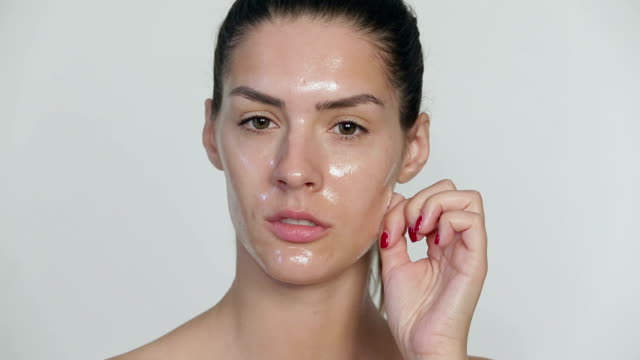 Young woman pulling peel off facial mask video