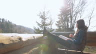 Young woman reading a book in nature. video