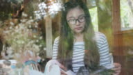 Young woman reading a book , Relaxation time video