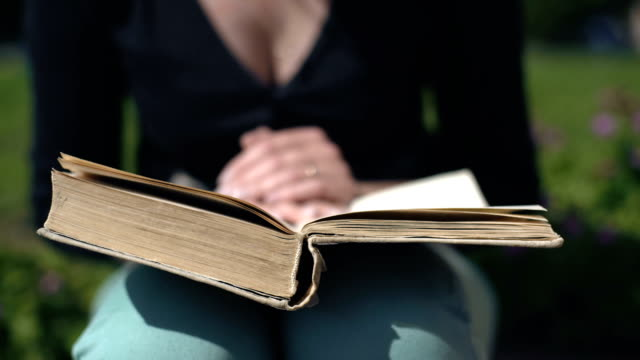Young woman reading a book video