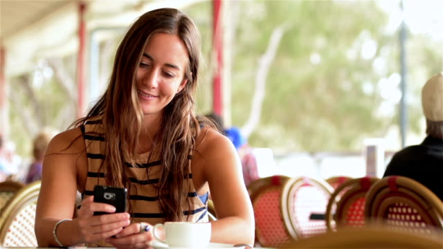 Young woman reading good news video