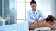 Young woman receiving back massage at spa video