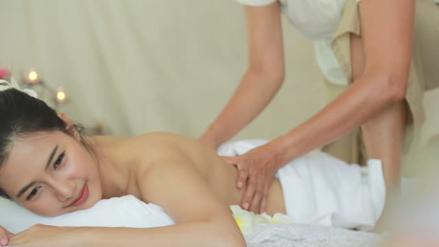 Young woman receiving back massage video