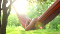 Young Woman Relaxing In A Hammock Super Slow Motion video