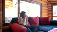 Young woman relaxing in the cabin. video