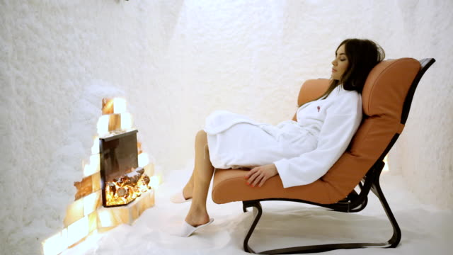 Young woman relaxing in the salt room (HD) video