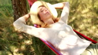 Young woman relaxing on a hammock in summer video