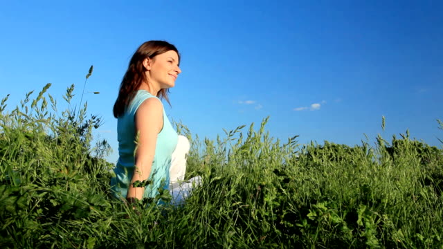 Young woman relaxing on meadow. video