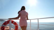 young woman relaxing on the deck of  ship video