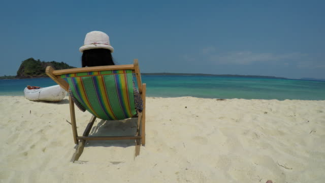 Young Woman Relaxing on Tropical Island Beach video