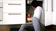 Young woman repairing sink with work tool video