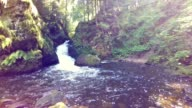 young woman resting by waterfall video