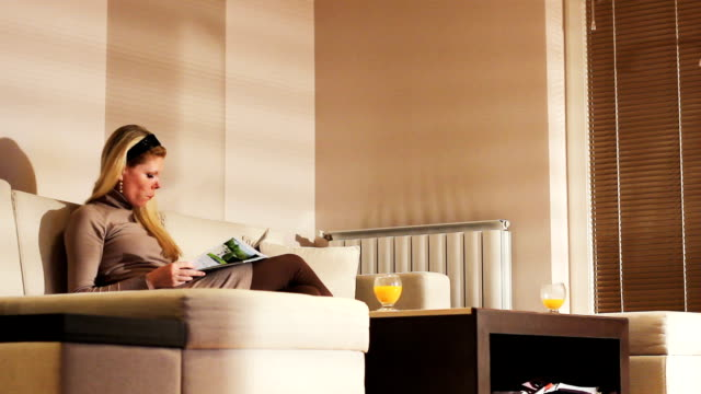 Young woman resting in luxury apartment video