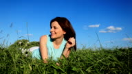 Young woman resting on the grass. video