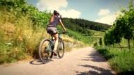 Young woman riding her mountain bike video