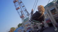 Young woman riding on chairoplane video