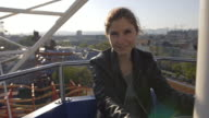 Young woman riding the ferris wheel above city of Vienna video