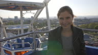 Young Woman Riding the Ferris Wheel video