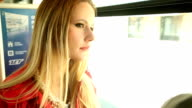 Young woman, riding tram and looking out the window video