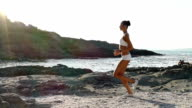 Young woman runing on the beach slow motion video