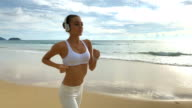 Young Woman Running Alone On The Beach video