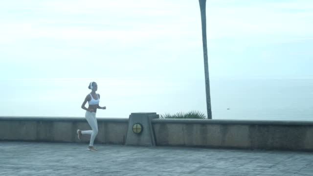 Young Woman Running Along The Embankment video