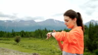 Young woman running in mountains on sunny summer day. Beauty female runner jogging and exercising outdoors in nature, rocky trail video