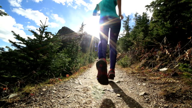 Young woman running in nature video