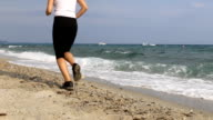 Young woman running on a beach video