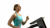 Young woman running on the treadmill. White background. video
