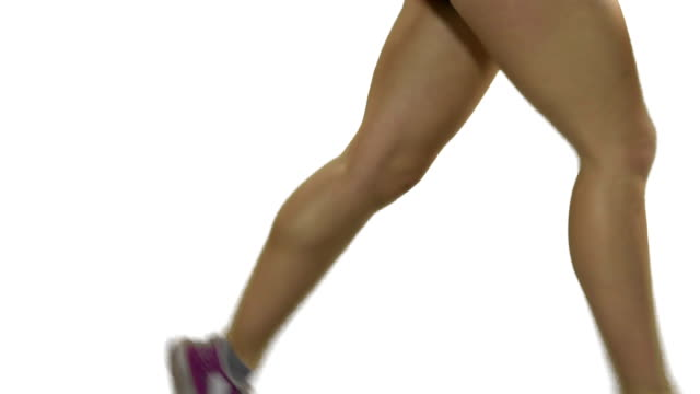 Young woman running on the treadmill. White screen. video