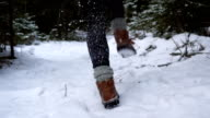 young woman runs in the snowy forest video