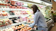 Young woman shopping fresh vegetable video