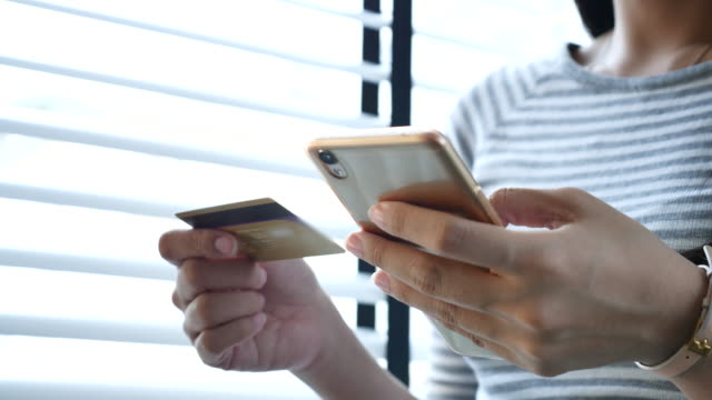 Young woman shopping online on smart phone video