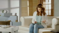 Young woman shopping online, using banking service on tablet PC video