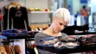 Young woman shopping video