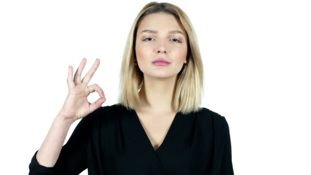 Young Woman Showing Ok Sign, White Background video