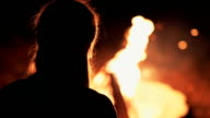 Young Woman Sitting by Campfire video