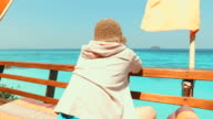 Young Woman Sitting on the Terrace at the Beach video