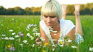 HD DOLLY: Young Woman Smelling Daisies video