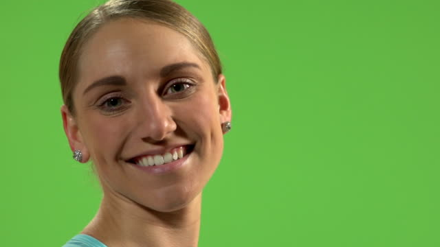 Young woman smiling to the camera. Green screen. video