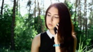 Young woman smoking a cigarette outdoor in slow motion video