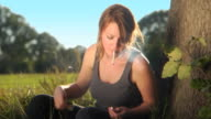 HD CRANE: Young woman smoking cigarette video