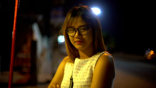 Young Woman standing in night street video