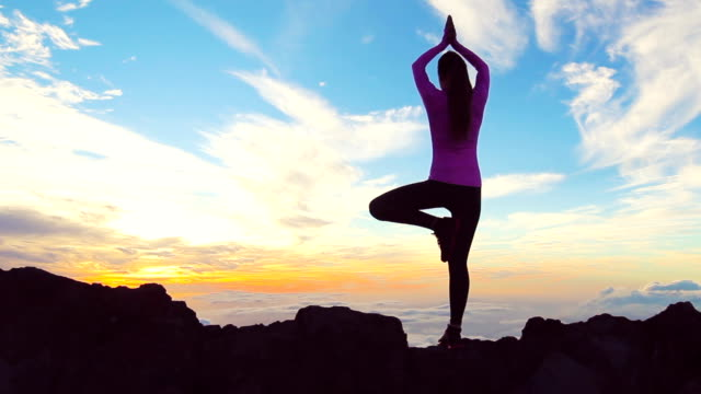 Young Woman Standing Yoga Pose on top of Mountain. Reaching the Top. video