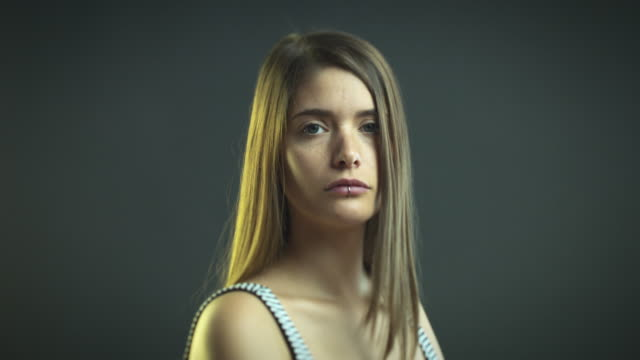 Young woman staring at camera video