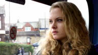 Young woman Staring out of the bus window video