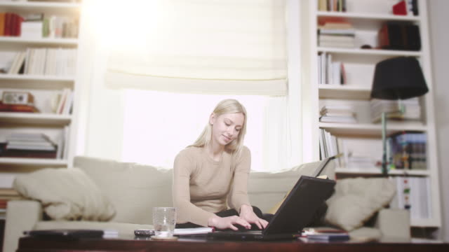 Young woman studying with laptop video