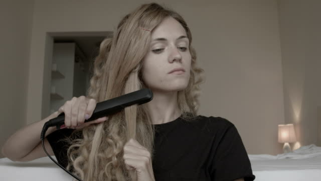 Young woman styling her hair video